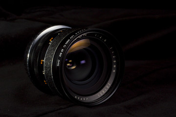 DSLR vintage wide lens close up with focus ring measures. Precise photography concept.