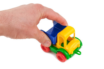 plastic toy car in the hand isolated on white