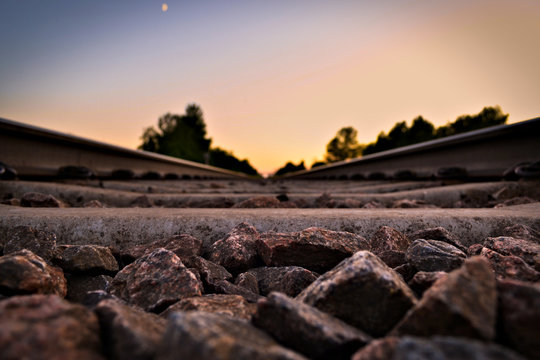 Beautiful close-up of track ballast with sunset background.