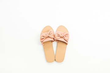 Pink female slippers on white background. Flat lay, top view. Summer fashion concept.
