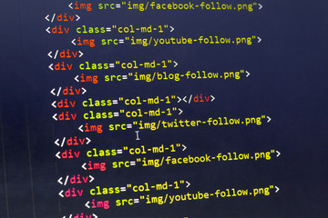 HTML with Bootstrap code of sharing website elements for most popular social networks. Web development source code abstract screen. Shallow depth of field. Code is created by myself.