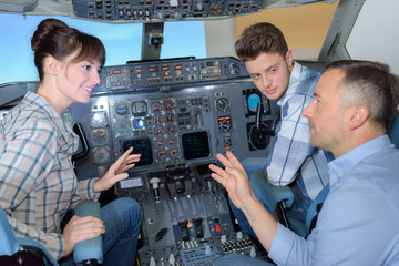 students and professor training in airliner simulator