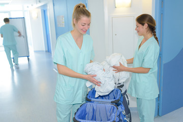 cleaning ladies doing housekeeping in clinic