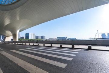 asphalt road with modern office building in urban
