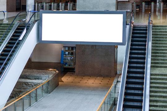 Blank billboard or mock up between the escalator in department store