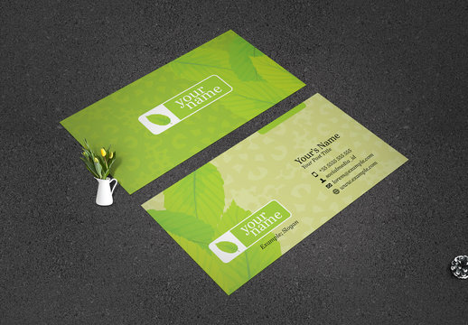 Business Card Layout with Green Foliage Elements