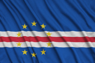 Cabo verde flag  is depicted on a sports cloth fabric with many folds. Sport team banner