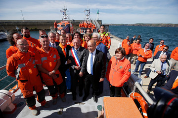 French President Emmanuel Macron poses aboard an ocean rescue boat with members of the Societe Nationale de Sauvetage en Mer (SNSM) in Camaret-sur-Mer