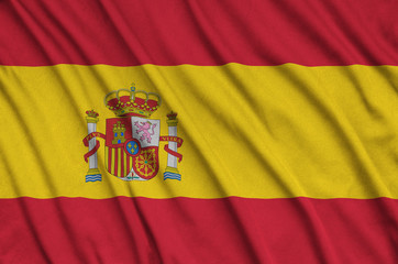 Spain flag  is depicted on a sports cloth fabric with many folds. Sport team banner