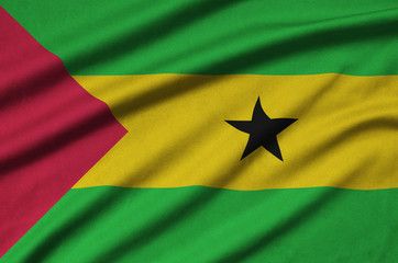 Sao Tome and Principe flag  is depicted on a sports cloth fabric with many folds. Sport team banner