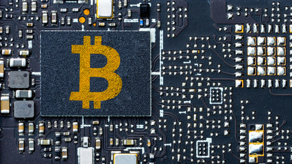Bitcoin concept with bitcoin microchips, circuit board background