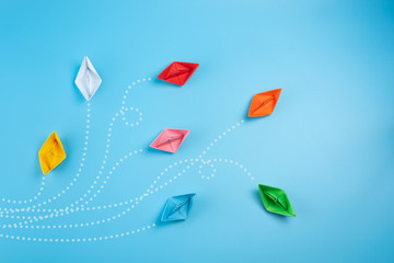 Paper ships on blue background. Business competition, different vision creative and Innovative...