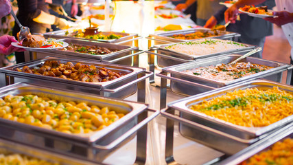 People group catering buffet food indoor in luxury restaurant with meat colorful fruits and vegetables.