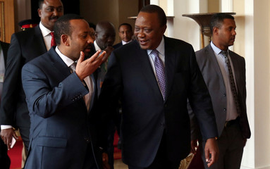 Kenya's President Uhuru Kenyatta is received by Ethiopia's Prime Minister Abiy Ahmed before the 32nd Extra-Ordinary Summit of IGAD Assembly of Heads of State and Government in Addis Ababa
