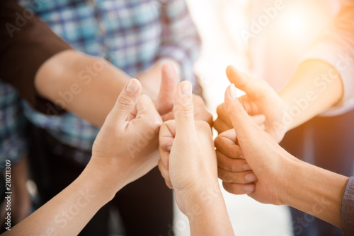 people thumb up in teamwork group people and business concept