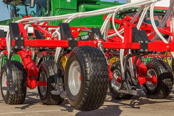 Mechanisms for the tractor are used for cultivating the land and planting seeds. Mechanization of agriculture.