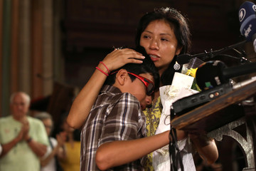 Debora Berenice Vazquez-Barrios embraces her son Kener as they appear at a news conference at the St. Paul and St. Andrew United Methodist Church in New York City