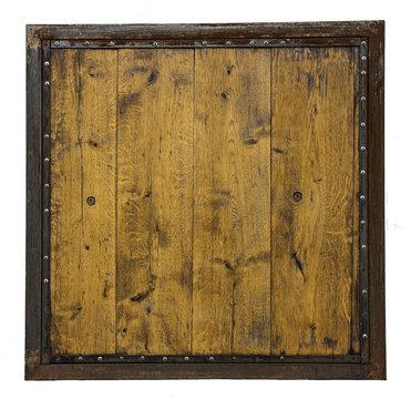 a wooden board made of wooden planks in a rusty metal frame with rivets isolated on white background