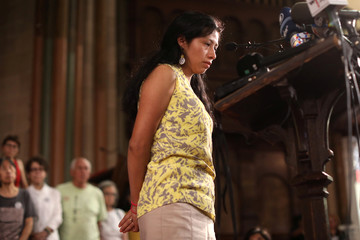 Debora Berenice Vazquez-Barrios pauses as she speaks at a news conference at the St. Paul and St. Andrew United Methodist Church in New York City