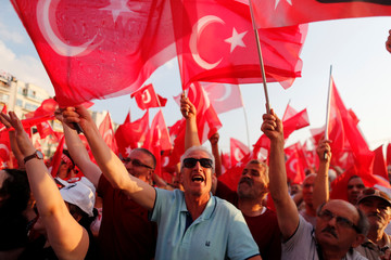 Supporters of Muharrem Ince, presidential candidate of the main opposition Republican People's Party (CHP), wave flags during an election rally in Izmir