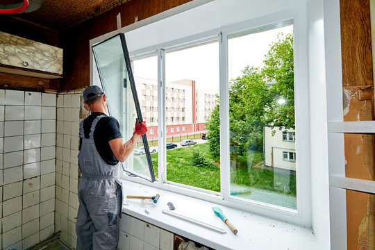 a man puts a plastic window