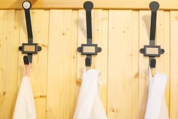 iron black hooks for clothes on wooden wall