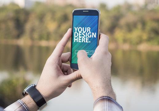 Hands Holding Smartphone in Natural Landscape Mockup