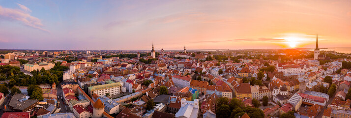 Beautiful orange sunset over old town of Tallinn in Estonia with the Raekoja plats, castle and old...