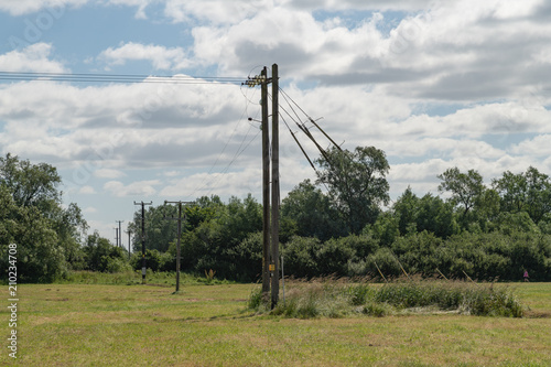 Wooden Electric Pole With Power Lines going into the distance