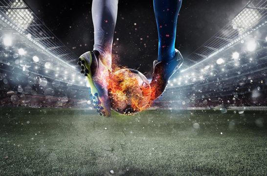 Soccer players with soccerball on fire at the stadium during the match