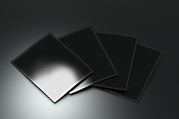 Four glossy shiny cards laying on the surface. Branding mock up. 3D illustration.