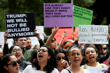 Women yell slogans during a protest against U.S. immigration policies in Mexico City