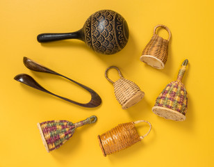 Traditional percussion instruments on yellow background
