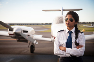 Female Pilot Standing in Front of Her Plane