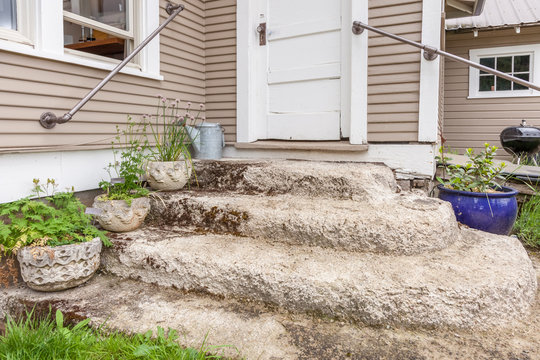 old cement steps in front of farmhouse
