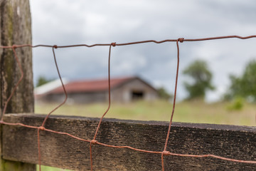 wire fence and barn
