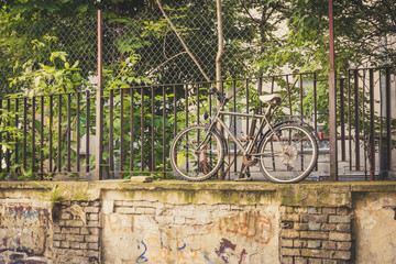 Funny pic of old bicycle standing on a high wall