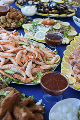Selection of cold bits, predominantly seafood at a buffet bar, or self-service restaurant. Assorted cold food displayed on individual plates at a wedding, birthday party or banquet.