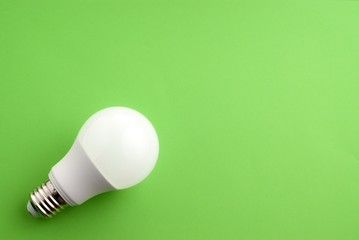 White lightbulb on a green background