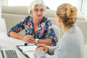 senior with banker meeting about contracting new credit
