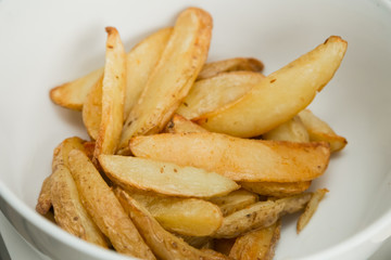 freshly baked potato wedges for catering at a corporate event