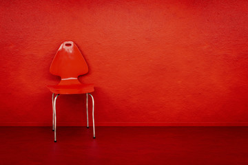 red chair at a red wall with space for your content