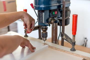 Carpenter drilling holes