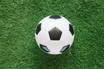Football background on grass with ball