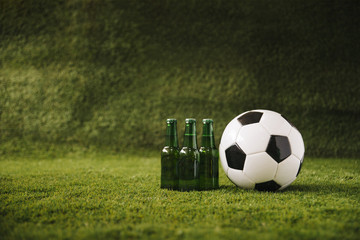 Football background with beer and ball