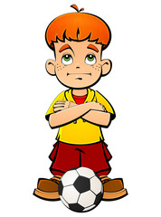 Red-haired boy with a soccer ball.