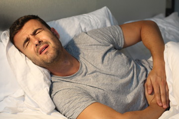 Man with stomach pain suffering