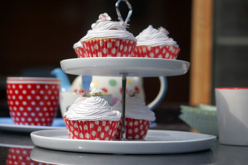 Cup cakes on a cake stand with pretty dotty cases