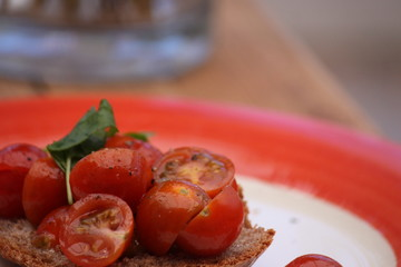 Fresh tomatoes served drizzled in olive oil on a bed of wholemeal toast