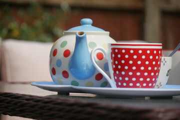 A dotty pot, with a bright dotty cup of tea